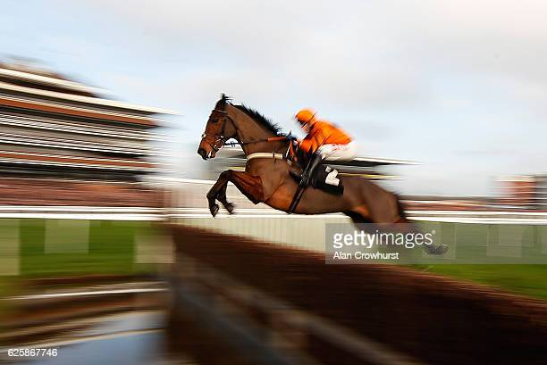 Tom Scudamore riding Thistlecrack clear the water jump before going on to win The bet365 Novices' Steeple Chase at Newbury Racecourse on November 26...