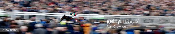 Tom Scudamore riding Un Temps Pour Tout win The Ultima Handicap Steeple Chase at Cheltenham racecourse on March 15 2016 in Cheltenham England