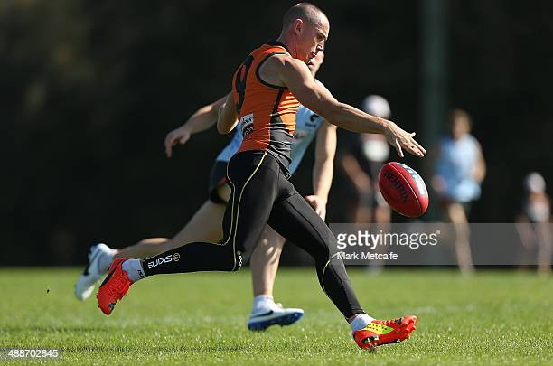 Tom Scully kicks during a Greater Western Sydney Giants AFL training session at Sydney Olympic Park Sports Centre on May 8 2014 in Sydney Australia