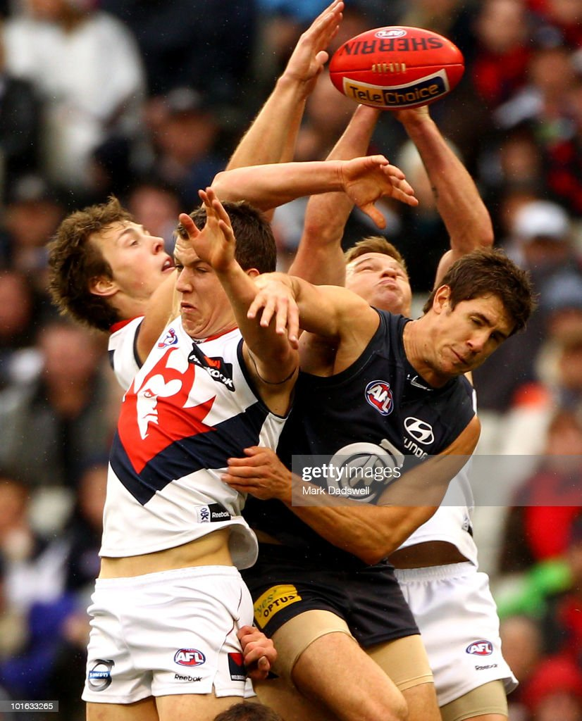 Tom Scully of the Demons flies for a mark with Jordan Russell of the Blues during the round 11 AFL match between the Carlton Blues and the Melbourne Demons at Melbourne Cricket Ground on June 5, 2010 in Melbourne, Australia.