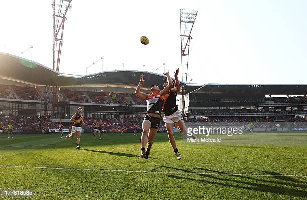Tom Scully of the Giants and Matt White of the Tigers compete for a mark during the round 22 AFL match between the Greater Western Sydney Giants and...