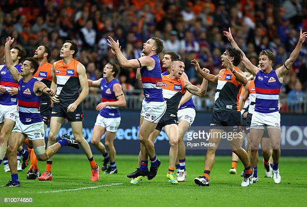 Tom Scully of the Giants celebrates before his shot on goal was ruled a behind during the AFL First Preliminary Final match between the Greater...