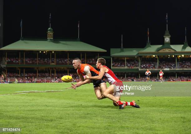 Tom Scully of the Giants is tackled by Will Hayward of the Swans during the round five AFL match between the Sydney Swans and the Greater Western...