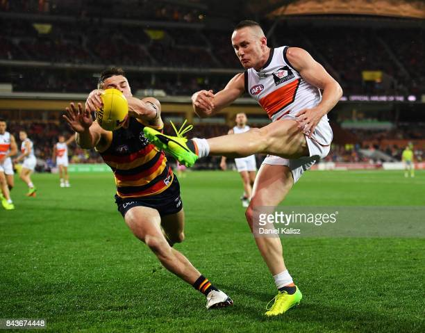 Tom Scully of the Giants kick is smothered by Brad Crouch of the Crows during the AFL First Qualifying Final match between the Adelaide Crows and the...