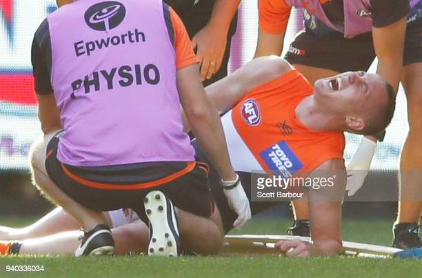 Tom Scully of the Giants lies on the field injured during the round two AFL match between the Collingwood Magpies and the Greater Western Sydney...