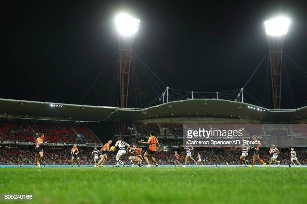 Tom Scully of the Giants looks to pass during the round 15 AFL match between the Greater Western Sydney Giants and the Geelong Cats at Spotless...