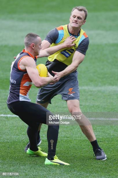 Tom Scully of the Giants pushes off assistant coach Dean Brogan during the Greater Western Sydney Giants AFL training session at Melbourne Cricket...