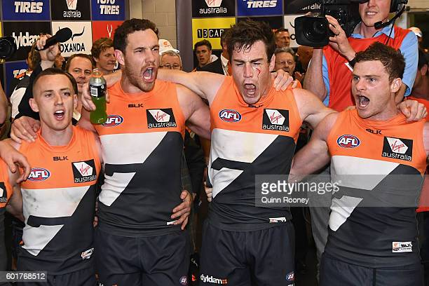 Tom Scully Shane Mumford Jeremy Cameron and Heath Shaw of the Giants sing the song in the rooms after winning the AFL 1st Qualifying Final match...