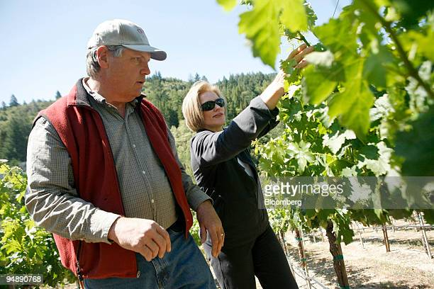 Tom Seaver former New York Mets Hall of Fame pitcher and his wife Nancy prune vines while checking for signs of new fruit growth at their 3acre...