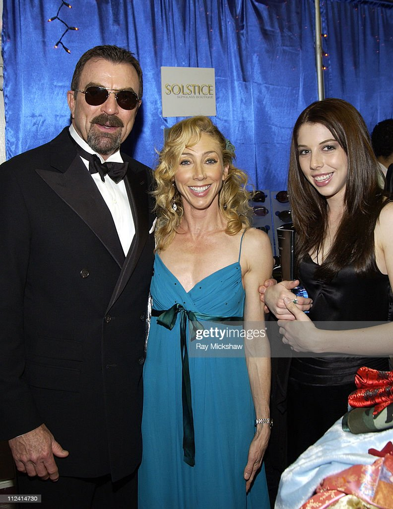 Tom Selleck wearing Giorgio Armani 261s sunglasses with wife Jillie Mack and daughter Hannah