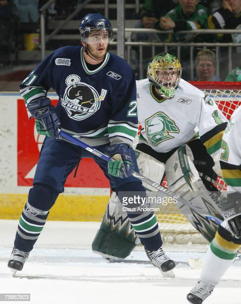 Tom Sestito of the Plymouth Whalers positions himself in front of Steve Mason of the London Knights in game one of the Western Conference Final on...