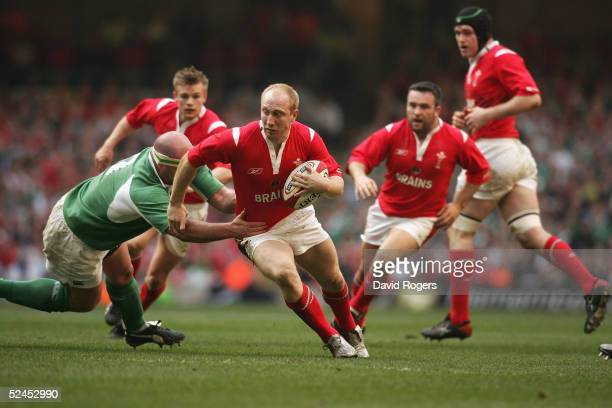 Tom Shanklin of Wales is held by John Hayes during the RBS Six Nations International between Wales and Ireland at The Millennium Stadium on March 19,...