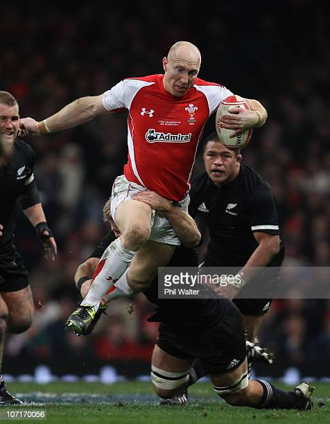 Tom Shanklin of Wales is tackled by Daniel Braid of the All Blacks during the Test match between Wales and the New Zealand All Blacks at Millennium...