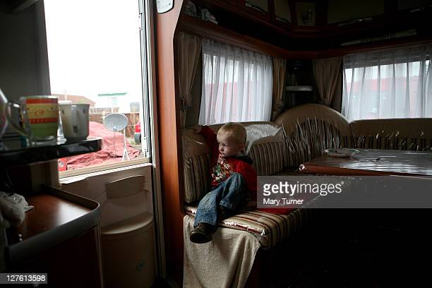 Tom Sherdidan sits in his family's caravan at Dale Farm Travellers camp on September 20 2011 near Basildon England Hundreds of travellers remain...
