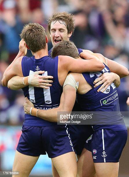 Tom Sheridan Michael Barlow and Stephen Hill of the dockers celebrate a goal during the Second AFL Qualifying Final match between the Geelong Cats...