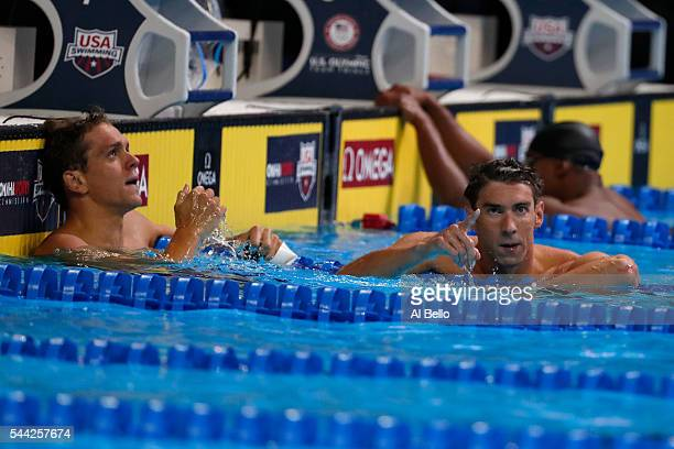 Tom Shields and Michael Phelps celebrate after competing in the final heat for the Men's 100 Meter Butterfly during Day Seven of the 2016 US Olympic...