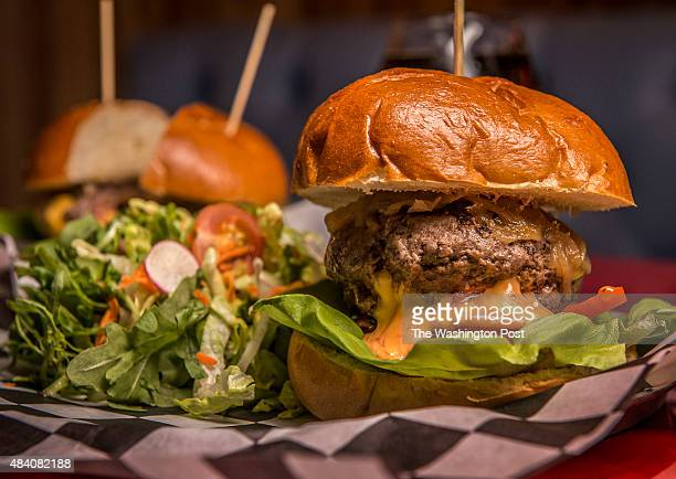 Tom Sietsema's First Bite on Slash Run on August 2015 in Washington DC Pictured a Juicy Lucy burger right served with salad greens