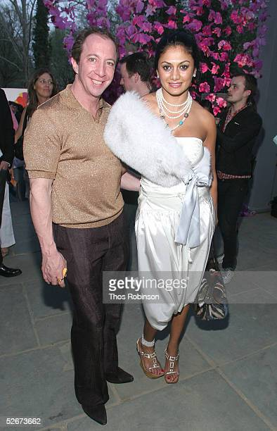Tom Silver and Donna D' Cruz attend the 'HM Live From Central Park' fashion show April 20 2005 in New York City