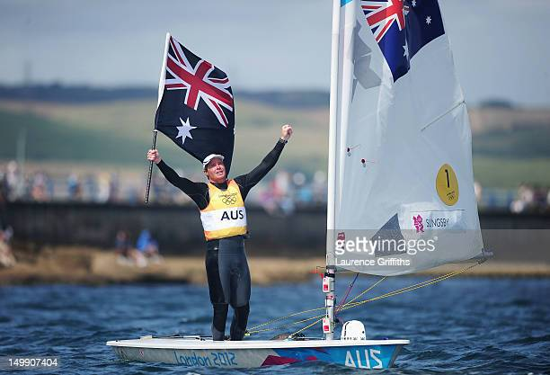 Tom Slingsby of Australia celebrates winning gold in the Men's Laser Sailing on Day 10 of the London 2012 Olympic Games at the Weymouth Portland...
