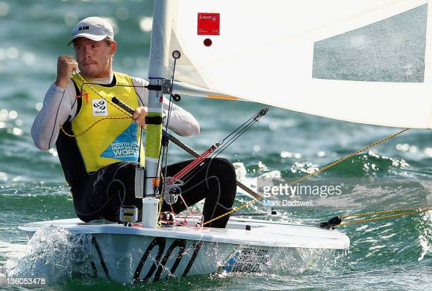 Tom Slingsby of Australia competes in the Laser Men's One Person Dinghy Medal race on the Centre Course during day 16 of the ISAF Sailing World...
