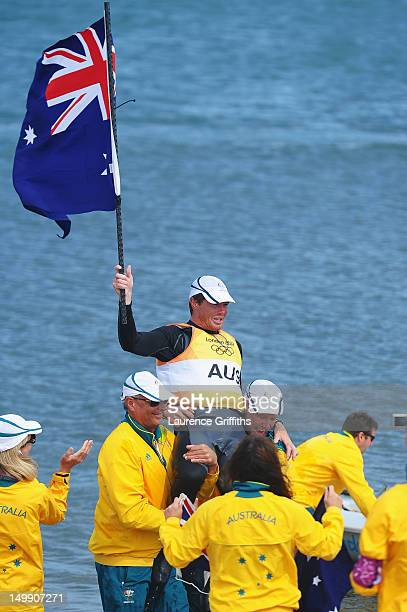 Tom Slingsby of Australia is lifted onto the shoulders of team mates after winning gold in the Men's Laser Sailing on Day 10 of the London 2012...