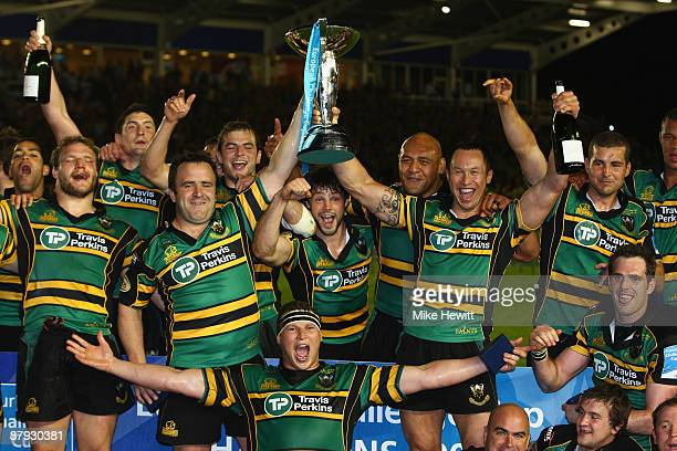 Tom Smith and Bruce Reihana of Northampton hold aloft the Challenge Cup trophy after victory in the European Challenge Cup Final between Northampton...