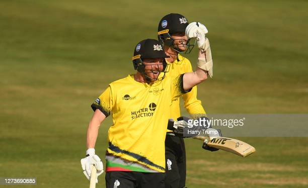 Tom Smith and David Payne of Gloucestershire celebrate as the final ball is hit for four to win the match during the Vitality Blast match between...