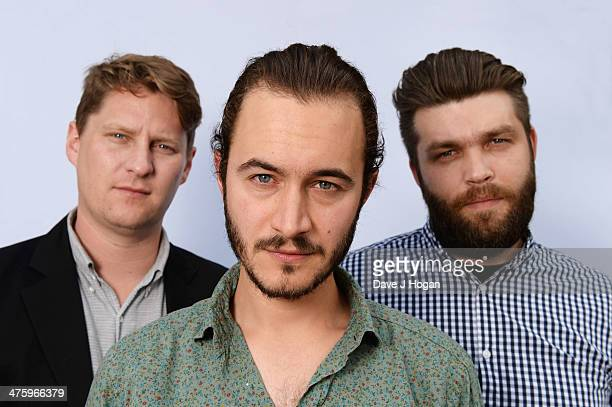 Tom Smith Justin Lockey and Russell Leetch of Editors performs for a Biz Session on June 17 2013 in London England