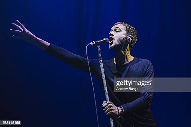 Tom Smith of Editors performs on stage at First Direct Arena Leeds on May 20 2016 in Leeds England