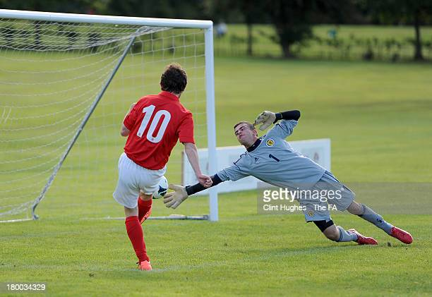 Tom Smith of England hits the ball past Scott Martin of Scotland to score his sides first goal during the Home Nations Cerebal Palsy Development...