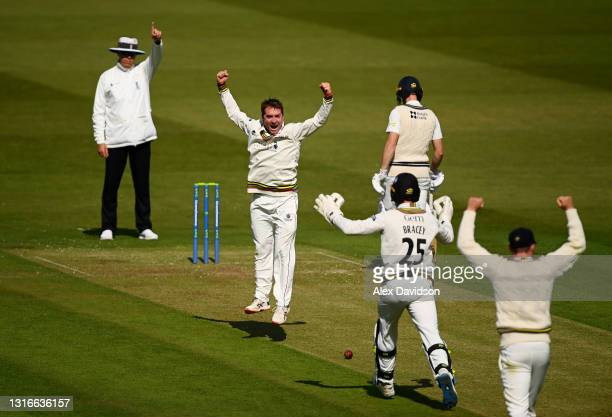 Tom Smith of Gloucestershire celebrates taking the wicket of John Simpson of Middlesex with James Bracey during Day One of the LV= Insurance County...