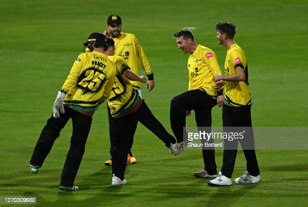 Tom Smith of Gloucestershire celebrates with team mates after taking a wicket during the T20 Vitality Blast 2020 match between Birmingham Bears and...