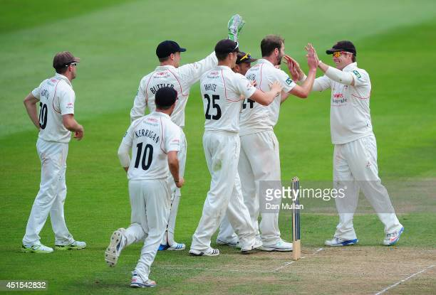 Tom Smith of Lancashire celebrates after taking the wicket of Marcus Trescothick of Somerset caught by Steven Croft of Lancashire during day three of...