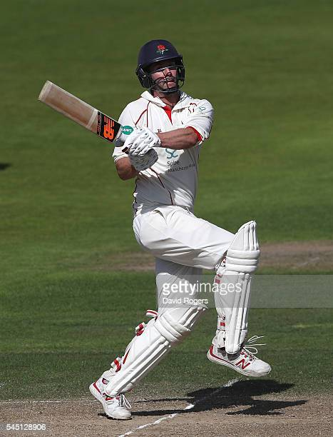 Tom Smith of Lancashire pulls the ball during the Specsavers County Championship division one match between Nottinghamshire and Lancashire at Trent...