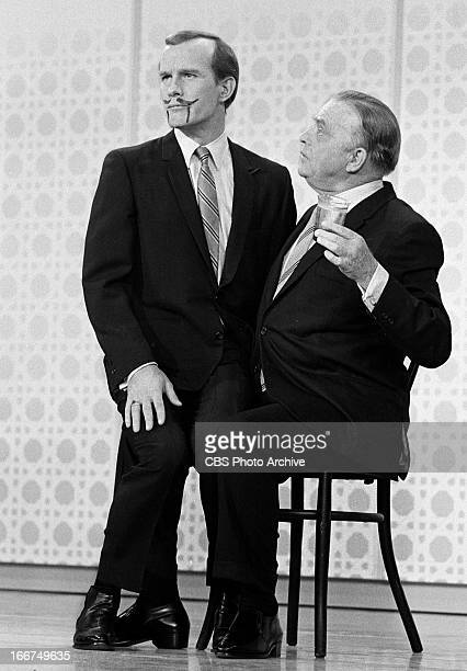 Tom Smothers sitting on Edgar Bergen's lap on THE SMOTHERS BROTHERS COMEDY HOUR Image dated December 8 1967