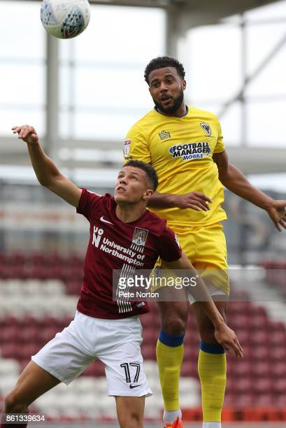 Tom Soares of AFC Wimbledon rises above Shaun McWilliams of Northampton Town to head the ball during the Sky Bet League One match between Northampton...
