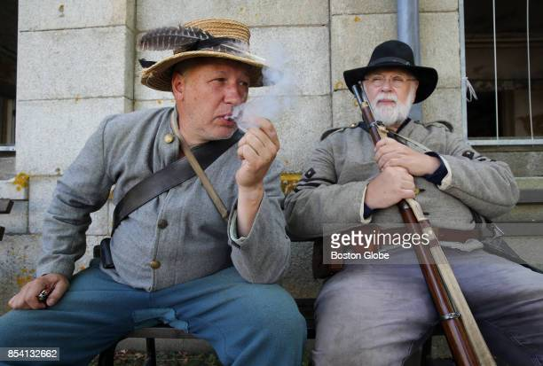 Tom Sommer left and Jack Jenkins relax while playing the part of Confederate troops during the Civil War Living History Reenactment at Historic Fort...