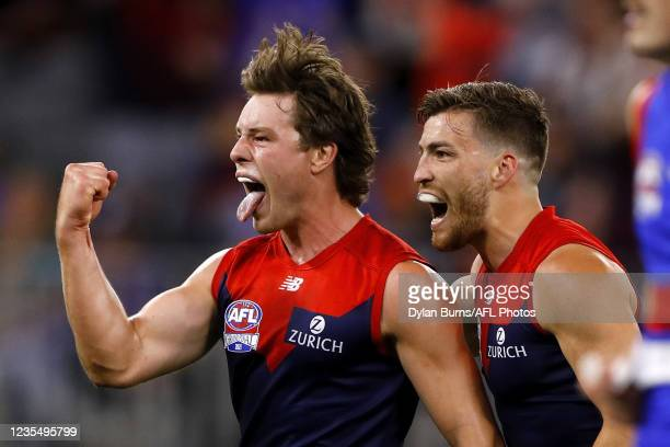 Tom Sparrow of the Demons celebrates a goal with Jack Viney of the Demons during the 2021 Toyota AFL Grand Final match between the Melbourne Demons...
