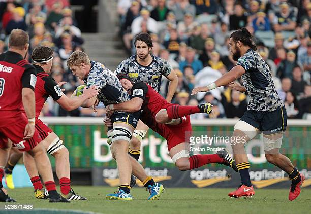 Tom Staniforth of the Brumbies is tackled during the round nine Super Rugby match between the Brumbies and the Crusaders at GIO Stadium on April 24...