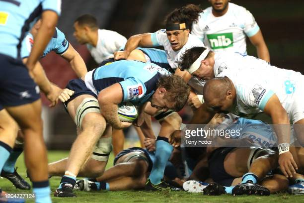 Tom Staniforth of the Waratahs plays the ball during the round 2 Super Rugby match between the Waratahs and the Blues at McDonald Jones Stadium on...