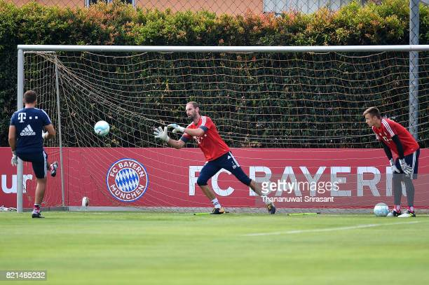 Tom Starke of FC Bayern Muenchen looks the ball during an International Champions Cup FC Bayern training session at Geylang Field on July 24 2017 in...