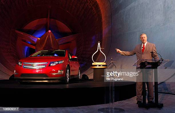 Tom Stephens GM Vice Chairman of Global Product Operations points to the Chevy Volt after it was named Motor Trend Car of the Year at the General...