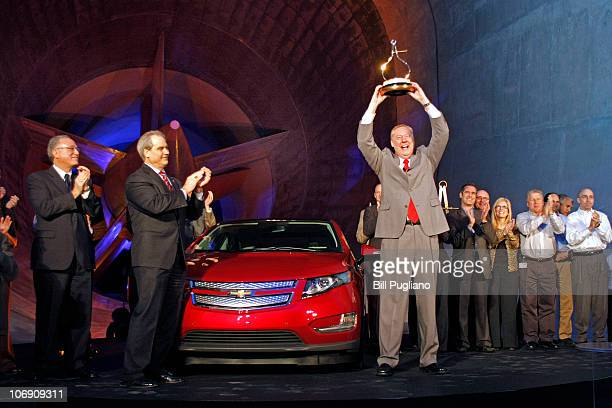 Tom Stephens GM Vice Chairman of Global Product Operations raises the Motor Trend Car of the Year Award as the Chevrolet Volt electric vehicle was...