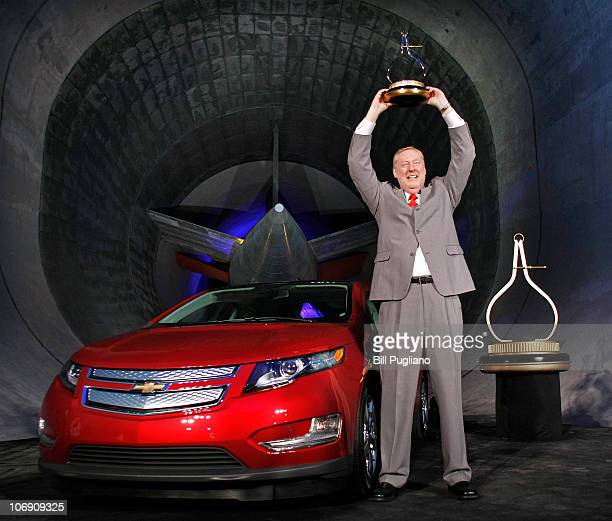 Tom Stephens GM Vice Chairman of Global Product Operations raises the Motor Trend Car of the Year Award for the cameras after the Chevrolet Volt...