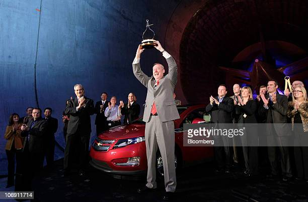 Tom Stephens vice chairman of global product operations for General Motors Co holds a trophy during the ceremony honoring the General Motors...