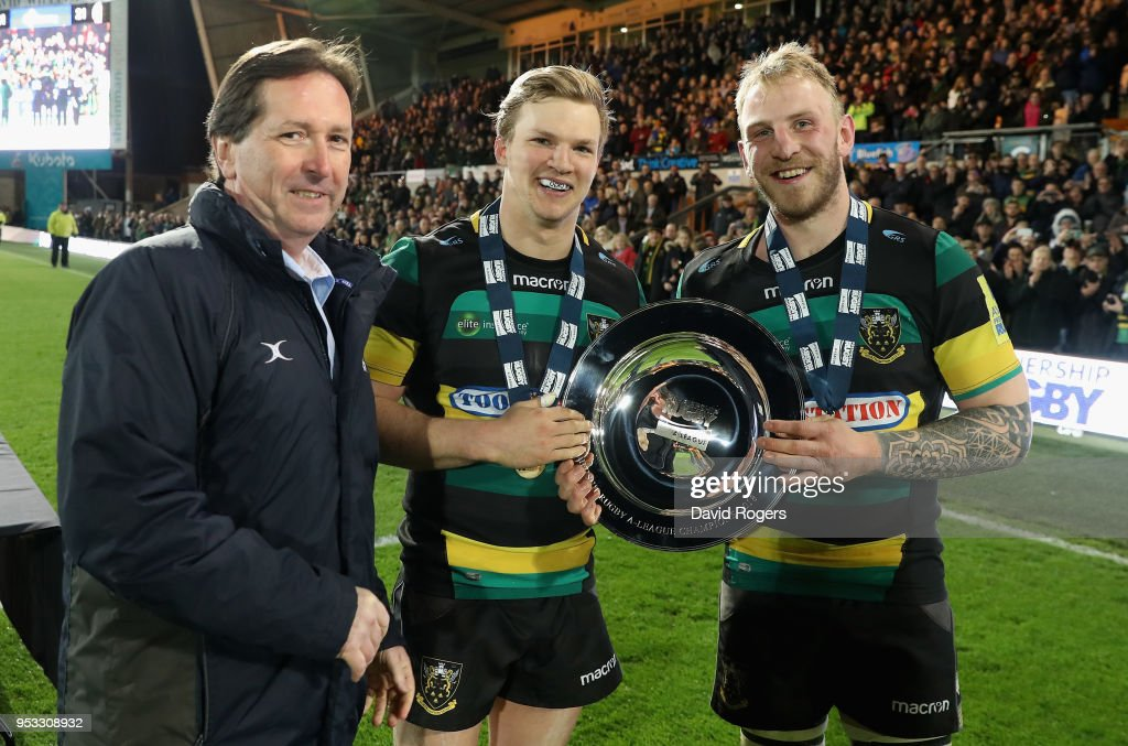 Tom Stephenson (C) and Ben Nutley the Northampton Wanderers receive the trophy from Premiership Rugby CEO Mark McCafferty (L) after their victory during the Aviva A League Final between Northampton Wanderers and Exeter Braves at Franklin's Gardens on April 30, 2018 in Northampton, England.