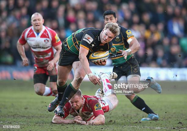 Tom Stephenson of Northampton breaks to score a try during the Aviva Premiership match between Northampton Saints and Gloucester at Franklin's...