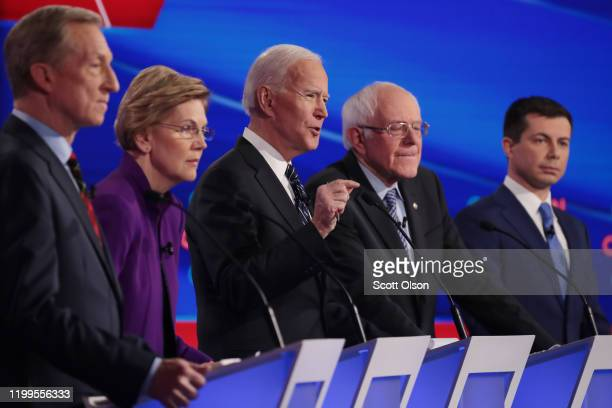 Tom Steyer , Sen. Elizabeth Warren , Sen. Bernie Sanders and former South Bend, Indiana Mayor Pete Buttigieg listen as former Vice President Joe...