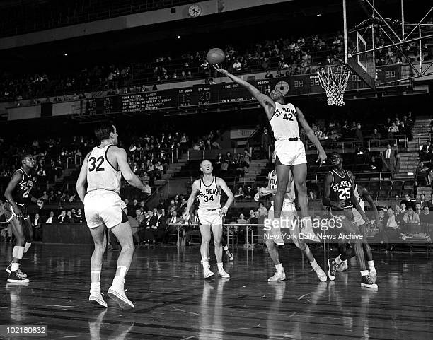 Tom Stith of the St Bonaventure Bonnies goes up for a rebound against the St John's Redmen during a game in the ECAC Holiday Tournament at Madison...