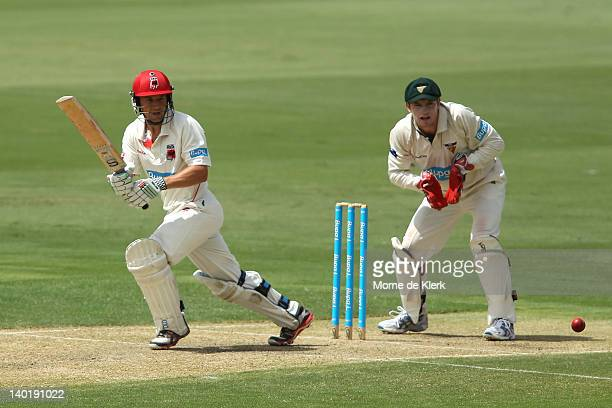 Tom Stray of the Redbacks bats in front of Brady Jones of the Tigers during day two of the Sheffield Shield match between the South Australia...